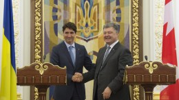 Prime Minister Justin Trudeau, left, and Ukrainian President Petro Poroshenko share a laugh at the end of joint news conference at the Presidential Administration building in Kyiv, Ukraine Monday July 11, 2016. THE CANADIAN PRESS/Adrian Wyld