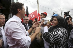 Liberal leader Trudeau greets a baby during a campaign stop in St. Catharines