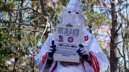 A member of the Ku Klux Klan who says his name is Gary Munker poses for a photo during an interview with AFP in Hampton Bays, New York on November 22, 2016.  Munker says his local branch of the KKK, which has recently placed recruitment flyers on car windshields on Long Island, has seen around 1,000 enquiries from people interested in joining since the election of Donald Trump.   / AFP / William EDWARDS        (Photo credit should read WILLIAM EDWARDS/AFP/Getty Images)