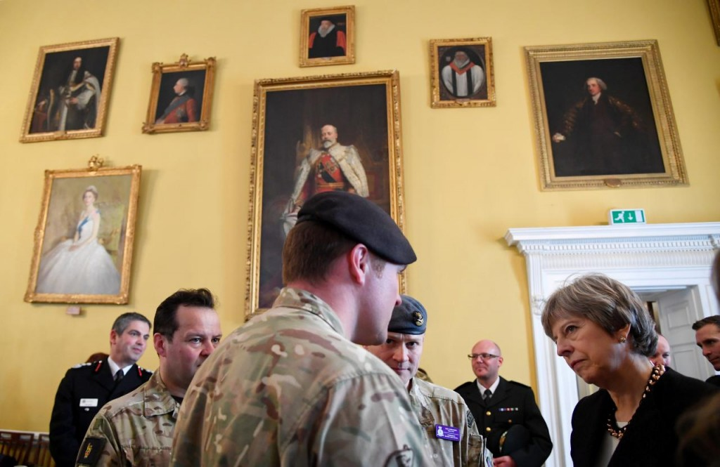 Britain's Prime Minister Theresa May speaks to local officials and members of the emergency services during a visit to the city where former Russian intelligence officer Sergei Skripal and his daughter Yulia were poisoned with a nerve agent, in Salisbury